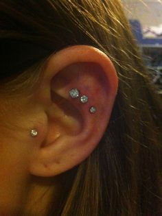 triple helix and tragus ear piercing. Ok this is awesome! I might do this! Maybe not three in a row though. Maybe just 2