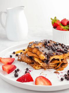 Eggless Vegan French Toast Jump to Recipe·Print Recipe An eggless french toast recipe with vegan coconut milk batter. Soft and pillowy insides with a crunchy sweet outside, all topped with maple syrup and fresh berries.French toast is my go-to Healthy Vegan Breakfast, Delicious Breakfast Recipes, Healthy Food List, Brunch Recipes, Pancake Recipes, Healthy Meals, Easy Recipes, Healthy Eating, Healthy Recipes