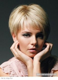 Stacked Bob Haircut | short bob hairstyle with stacked layers side view. This level 9 bob with stacked layers would be cut with shears and either thinning shears or razor to give layers, depending on the thickness. I'd suggest perfect for platinum products, and ask to see her in 6 weeks for root touch up, and suggest manicure for all over look.