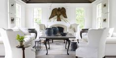 There are lots of showstoppers in designer Nancy Braithwaite's Atlanta house, and most of them—from the sunroom's lordly eagle to the faux sheep on the velvety lawn—come with a droll backstory. The house, of course, has a story all its own. In the sunroom, oversize black objects have a sculptural effect against crisp white walls and upholstery. Antique wing chairs and custom sofa in Great Plains for Holly Hunt linen. Stools, Christian Liaigre. Urns, Balsamo Antiques. Walls in Pearly Gates…