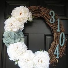 Front door wreath with house number