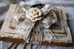 Rose and lace on book
