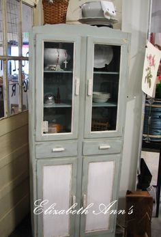 Cute vintage cupboard painted with ASCP lightened Duck Egg & Pure White.