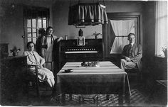 1920s living room – look at that LAMP, that LINO, and the piano (organ?) tucked in
