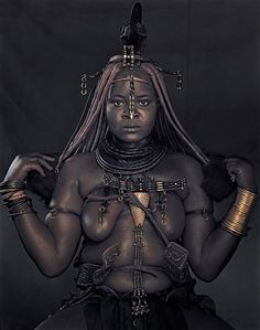 Her name is Peraa Muhenje-The Himba are an ancient indigenous group of tall, slender and statuesque herders. Since the 16th century they have lived in scattered settlements, leading a life that has remained unchanged, surviving war and droughts. The tribal structure helps them live in one of the most extreme environments on earth.