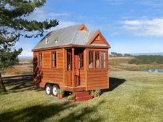 Tumble Weed Tiny House Company:    The Weebee boasts the wonderful bump-out windows in the front. The interior is completely finished in pine with stainless steel counters. The exterior of this house is finished with cedar plank siding and a corrugated aluminum roof. Yes, when it rains, you can hear it. The Weebee can also be finished with board and batten siding or corrugated aluminum.