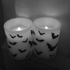 Buy some flameless candles and paint decorations onto them??? Could do bats, witch hats, ghosts, leaves! Have to do this! Kohls has a ton of clearance flameless candles! ;)