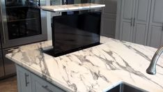 Our Modern Kitchen Marble Countertop Kitchen Island for an updated kitchen project, we actually put a flat screen TV inside the countertop! For an awesome kitchen and inspirational design! Tv In Kitchen, Modern Kitchen Island, Updated Kitchen, Home Decor Kitchen, Kitchen Interior, Marble Island Kitchen, Modern Kitchen Designs, Smart Kitchen, Kitchen Countertop Decor