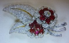 The Queen`s ruby flower & diamond leaves Greville brooch.
