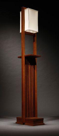 A Frank Lloyd Wright designed walnut floor lamp