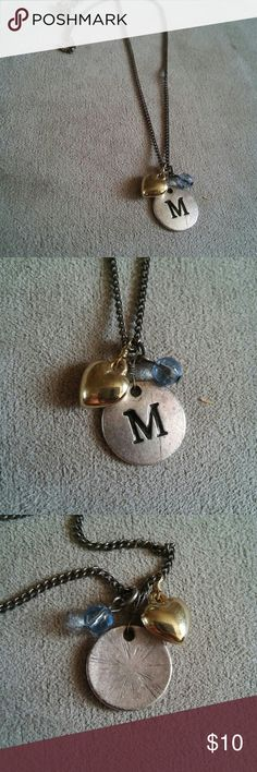 """2 for $12 """"M"""" Charm Necklace Adjustable necklace with three charms * Metal circle charm with the letter M engraved * Plastic blue bead * Metal, gold 3D heart pendant * Lobster claw clasp * Necklace shown at longest length in last picture * In excellent condition * Offers accepted! Jewelry Necklaces"""