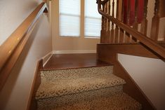 transition from hardwood flooring to carpeted stairs