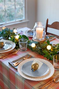 Look no further than a garland for a pretty Christmas-themed table runner.