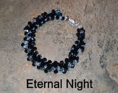 A striking combination in jet black and crystal silver night beads