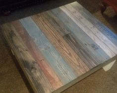 Reclaimed Wood Coffee Table With Multi Color Stain.