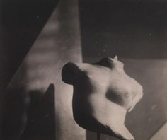 Marble torso from 21 rue Bonaparte, 1920. Photograph. Exhibition Eileen Gray: the private painter. Image courtesy of the Osborne Samuel Gallery. Click above to see larger image.