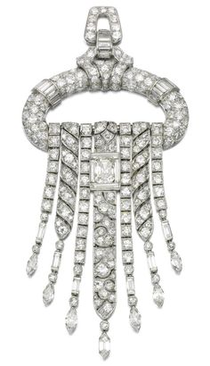 Diamond pendant/brooch, 1930s. The geometric surmount suspending a graduated series of articulated tassels, set with variously cut diamonds including circular-, single-cut, marquise-shaped and baguette, the central tassel highlighted with a step-cut diamond within a frame of baguette diamonds, French assay and maker's marks, detachable pendant loop and brooch fitting, fitted case.