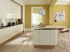 Remo Alabaster Curved Gloss Kitchen with a Curved Island with a Shaped Maple Worktop Kitchen Colour Schemes, Kitchen Wall Colors, Kitchen Paint, Cream Kitchen Units, Cream Gloss Kitchen Decor, Kitchen Cupboards, Mustard Kitchen, Kitchen Yellow, Curved Kitchen Island