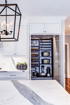 Store Pots In Your Pantry - 10 Ways To Get Your Kitchen In Gear This Year - Photos