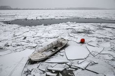 Belgrade, Serbia:   A small boat is trapped in the frozen Danube river on Jan. 17.