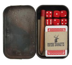 Game Kit - Smart way to store some fun for the adventuring. Pack of cards, some dice, pad of paper, and a pencil in an altoids can.
