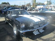 Black car with white stripes