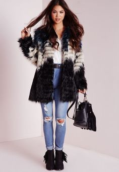 Cause a little chaos in this seriously standout faux fur coat. With multi-coloured black, navy and cream colour block detailing this beaut will turn heads. Team over black skinny jeans and high neck top for a jaw to the floor finish.   Ap...