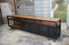 Cool workbench, industrial, could be modified as a chopsaw table, metal and cherry.