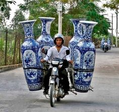 transporting these heavy, humongous vases in a moped?