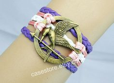 Mockingjay pin braceletLavender leather by charmcover on Etsy, $7.99