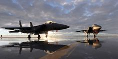 Two F-15E fighter jets on a runway at sunset : Free Stock Photo