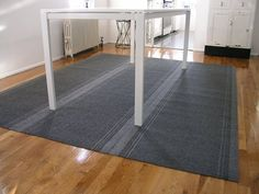 Inexpensive (cheap!) area rug for dining room floor - Home Depot rolled carpet, duct tape & it's done! Easy!