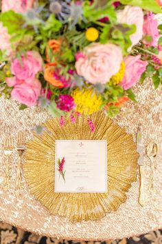 Dazzling gold reception place setting, springtime floral centerpieces, gold sequin tablecloth, gold utensils // Drew Brashler Photography
