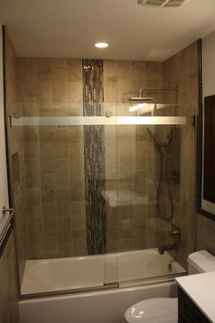 Newly remodeled bathroom using Crossville Manoir 6x12 Hermitage and Ebb & Flow Dusk & Dawm mosaics.