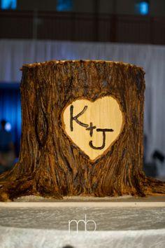 Barb Sullivan of Barb's Cakes created this monogrammed tree trunk cake! #dorothymcdanielsflowermarket #weddingcake #treetrunkcakes