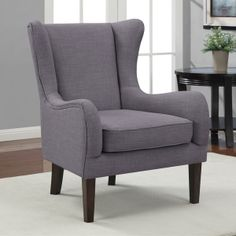 this curved wing chair features a beautiful grey colored linen look fabric upholstery this chair highlights graceful back and arms that create an elegant