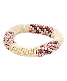 This Cream & Pink Woven Bead Stretch Bracelet is perfect! #zulilyfinds #jewelry #jewelrysale #sale #fashion #fashionjewelry #pavcusdesigns #pavcus #womensfashion #womensjewelry #bracelet #earrings #necklace #springcollection