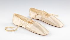 slippers circa 1844, shoes of the time were typically flat, silk or satin and had square toes.
