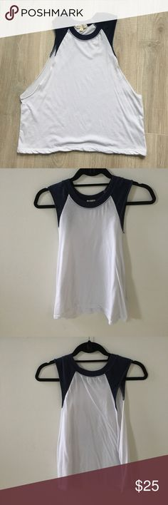 Nasty Gal White & Navy Baseball Muscle Tank Top Nasty Gal White & Navy Baseball Muscle Tank Top! This top is in great condition and has only been worn a handful of times! The top shows no signs of stains or damage! This top looks great with dark washed denim jeans and converse/cute sneakers and a white baseball cap! EUC!!! Nasty Gal Tops Muscle Tees