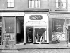 92 Gorbals St, 1931  Love so much about this photo... the close, the stained glass in the flat windows, the variety of shops & the people watching the camera! x