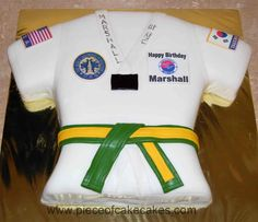 The birthday boy wanted a Tae Kwon Do birthday cake. This is his uniform. Yellow cake covered in fondant. Patches are edible images. Belt is fondant.