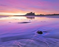 Bamburgh Castle at dawn - Northumberland, England Romantic Weekend Breaks, Northumberland Coast, Berwick Upon Tweed, Sunset Images, Dawn And Dusk, England And Scotland, Seascape Paintings, British Isles, Vacation Destinations