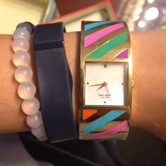 Striped Kate spade bangle watch Gold-tone bangle watch with multi-colored stripes on band and square dial featuring spade logo at 12 o'clock Japanese quartz movement with analog display Protective mineral crystal dial window Features bangle closure Not water resistant Product Details Department: womens Manufacturer: kate spade new york Manufacturer reference: 1YRU0190 Product Dimensions: 3.8 x 3.7 x 3.6 inches; 7.2 ounces NO TRADES. Please use the make an offer function as I do not negotiate…