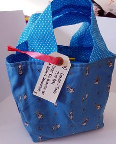 Great for kids lunches.or just a novelty bag Blue Peter rabbit fabric on outside. Turquoise spots Measures approx wide and high Lunch Tote Bag, Pet Bag, Blue Peter, Peter Rabbit, Blue Bags, Diaper Bag, My Etsy Shop, Reusable Tote Bags, Purses