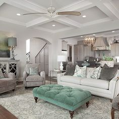 Love that the big pieces are neutrals and a pop of color is introduced through decor and accent pieces. By McLain Homes