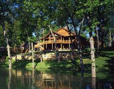 Built at the water's edge of Table Rock Lake in Missouri, this log home typifies the feel and style of a grand lodge.