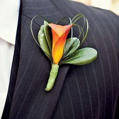 Calla Lily Boutonniere - The Groom's Boutonniere - Southernliving. Try a calla lily in a vibrant shade for an elegant touch.Kelley's Bloom Room from the wedding of Hillery Cunningham and Ricky Shephard Calla Lily Boutonniere, Calla Lily Bouquet, Groomsmen Boutonniere, Groom And Groomsmen, Boutonnieres, Wedding Boutonniere, Fall Wedding Flowers, Orange Wedding, Calla Lilies