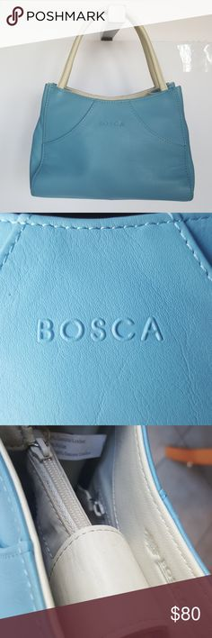 Bosca small Blue purse very small Bosca top handle leather  purse. One zipper nylon pouch one side zipper pocket. Inside trimed in white leather with nylon lining. Front and back features slit pockets can fit an ID and a credit card. This is a used bag shows wear and some slouching while sitting up. Leather handle shoe no cracking. the bag feel very soft to the touch. Bosca Bags Mini Bags