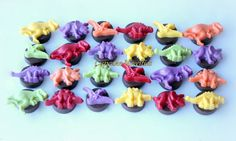 Buy online on Etsy! Delicious Dinosaur themed Chocolate covered Oreo cookies great for birthday party or baby shower favors & dessert table treats! Green, purple, orange & yellow chocolate dinosaurs on yummy Chocolate covered Oreos!