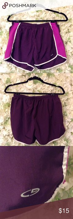Champion Small Track Shorts Champion Small Track Shorts. The main color is Dark Purple with white and light purple sides. Ties in the middle inside. Has the attached Underwear Champion Shorts